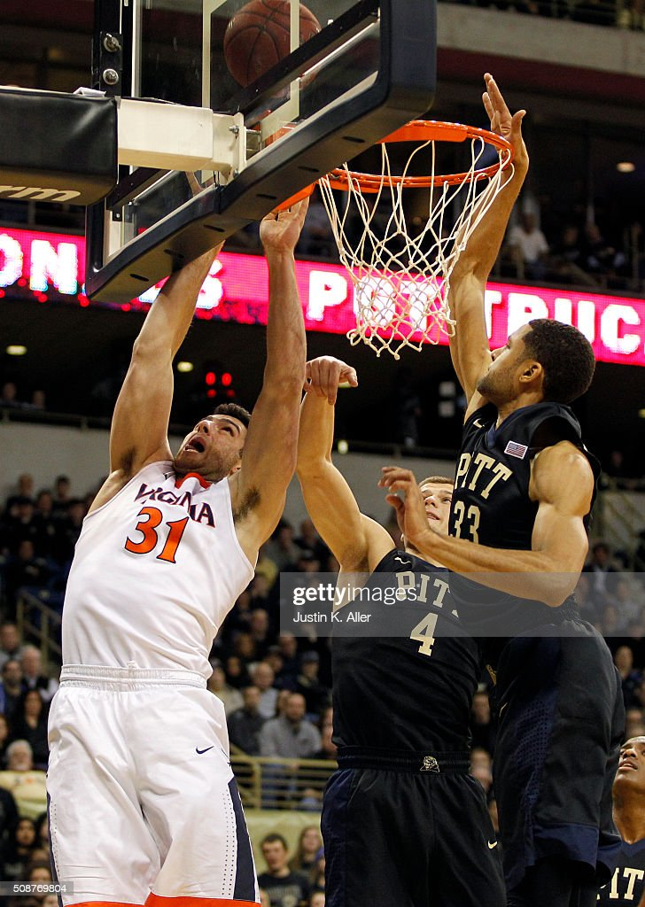 Jarred Reuter #31 of the Virginia Cavaliers battles under the hoop against Ryan Luther #4 and Alonzo Nelson-Ododa #33 of the Pittsburgh Panthers during the game at Petersen Events Center on February 6, 2016 in Pittsburgh, Pennsylvania.