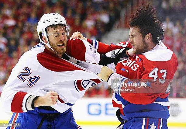Jarred Tinordi of the Montreal Canadiens and Tom Wilson of the Washington Capitals exchange punches during the first period at Verizon Center on...