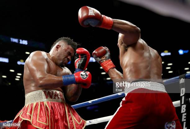 Jarrell Miller and Gerald Washington exchange punhes during their heavyweight match on July 29 2017 at the Barclays Center in the Brooklyn borough of...