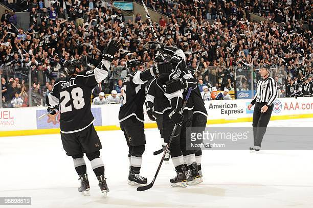 Jarret Stoll and Alexander Frolov of the Los Angeles Kings celebrate with teammates after a goal against the Vancouver Canucks in Game Six of the...