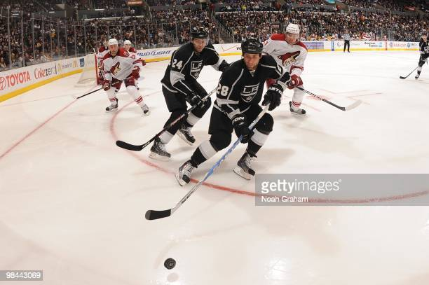 Jarret Stoll and Alexander Frolov of the Los Angeles Kings go for the puck against the Phoenix Coyotes on April 8 2010 at Staples Center in Los...