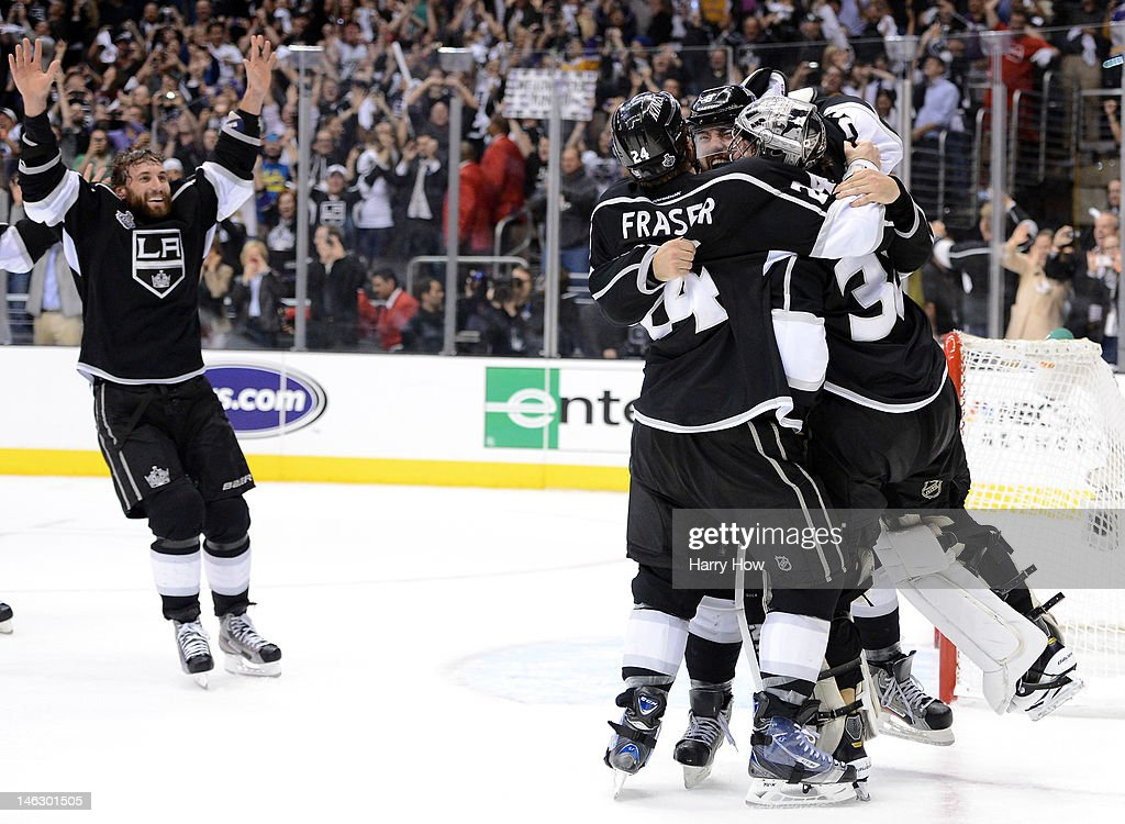 Jarret Stoll #28, Colin Fraser #24, Drew Doughty #8 of the Los Angeles Kings surround goaltender Jonathan Quick #32 of the Los Angeles Kings after winning Game Six of the 2012 Stanley Cup Final 6-1 to win the series 4-2 at Staples Center on June 11, 2012 in Los Angeles, California.
