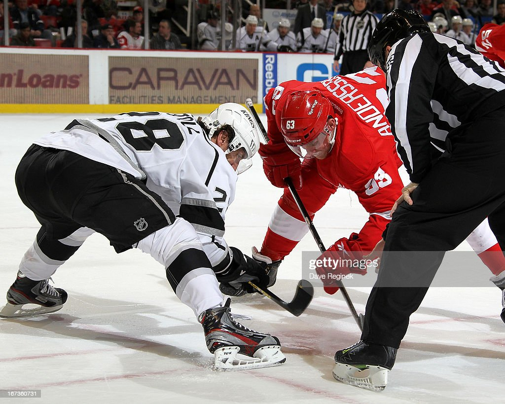 Jarret Stoll #28 of the Los Angeles Kings and Joakim Andersson #63 of the Detroit Red Wings face off during a NHL game at Joe Louis Arena on April 24, 2013 in Detroit, Michigan.