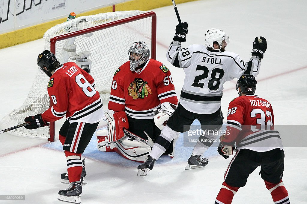 Jarret Stoll #28 of the Los Angeles Kings celebrates the game winning goal against Corey Crawford #50 of the Chicago Blackhawks in overtime 5 to 4 to win Game Seven of the Western Conference Final in the 2014 Stanley Cup Playoffs at United Center on June 1, 2014 in Chicago, Illinois.