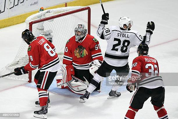 Jarret Stoll of the Los Angeles Kings celebrates the game winning goal against Corey Crawford of the Chicago Blackhawks in overtime 5 to 4 to win...