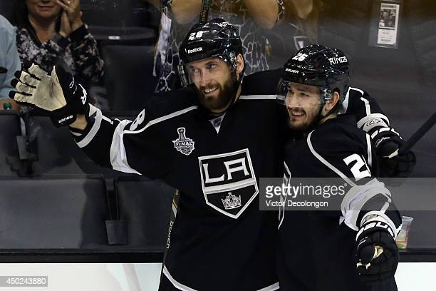 Jarret Stoll of the Los Angeles Kings celebrates with teammate Slava Voynov after scoring a goal against Henrik Lundqvist of the New York Rangers in...
