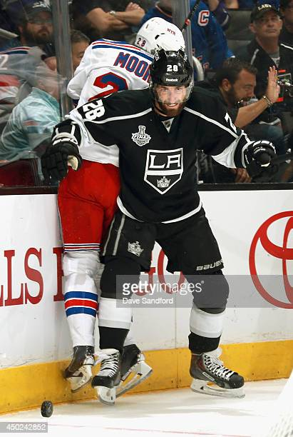 Jarret Stoll of the Los Angeles Kings checks Dominic Moore of the New York Rangers during the first period of Game Two of the 2014 Stanley Cup Final...