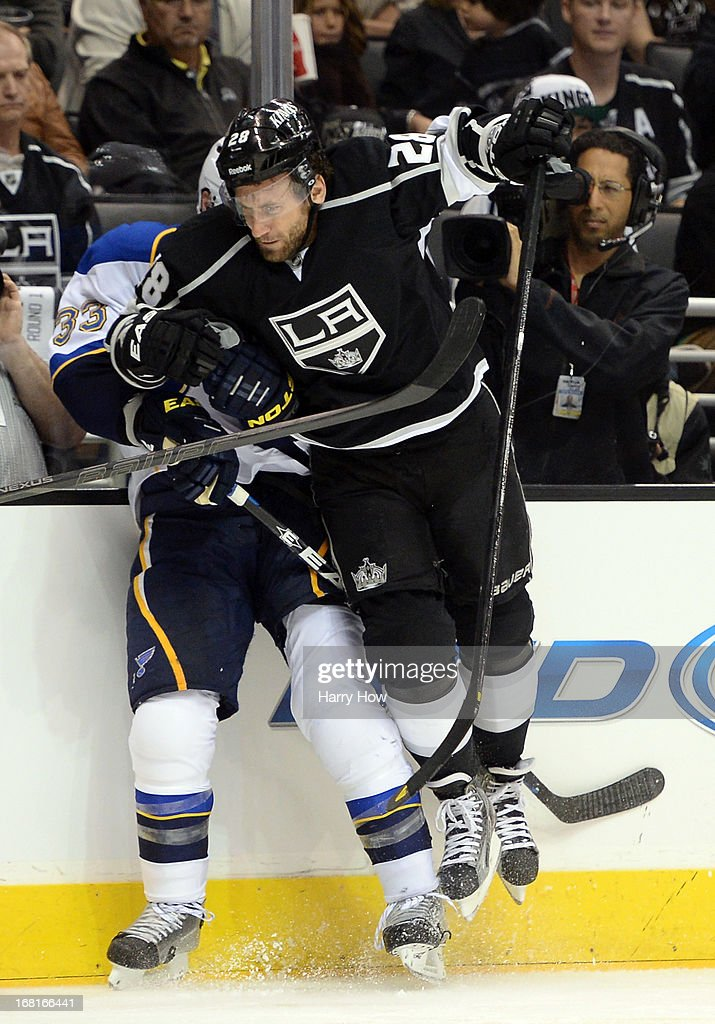 Jarret Stoll #28 of the Los Angeles Kings checks Jordan Leopold #33 of the St. Louis Blues during a 1-0 Kings win in Game Three of the Western Conference Quarterfinals during the 2013 NHL Stanley Cup Playoffs at Staples Center on May 4, 2013 in Los Angeles, California.