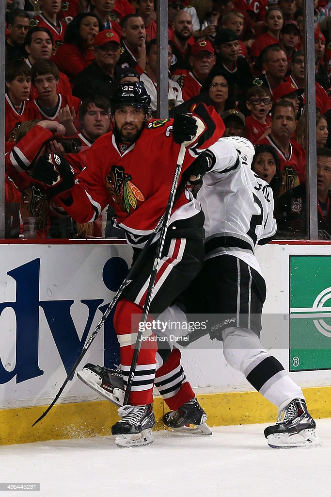 Jarret Stoll #28 of the Los Angeles Kings checks Michal Rozsival #32 of the Chicago Blackhawks during Game Seven of the Western Conference Final in the 2014 Stanley Cup Playoffs at United Center on June 1, 2014 in Chicago, Illinois.