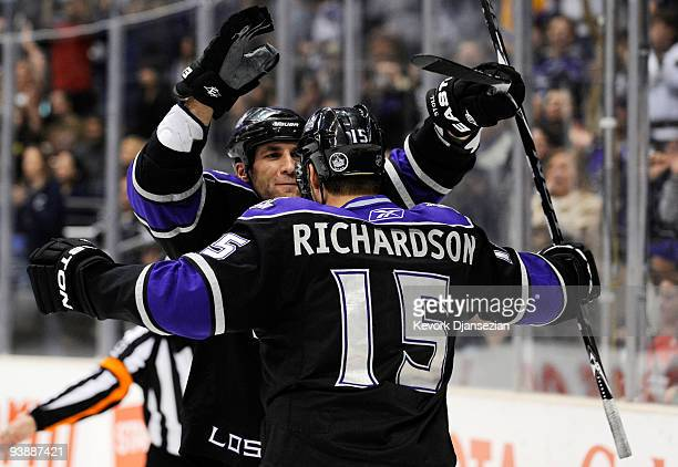 Jarret Stoll of the Los Angeles Kings congratulates Brad Richardson after he scored a goal against Ottawa Senators during third period of the NHL...