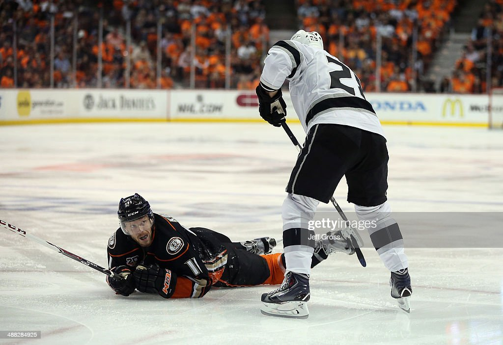 Jarret Stoll #28 of the Los Angeles Kings gets his stick caught in the skate of Saku Koivu #11 of the Anaheim Ducks in the first period of Game One of the Second Round of the 2014 NHL Stanley Cup Playoffs at Honda Center on May 3, 2014 in Anaheim, California.