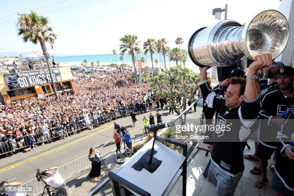Jarret Stoll of the Los Angeles Kings hoists the Stanley Cup up in the air during the Los Angeles Kings South Bay Victory Parade on June 18 2014 in...
