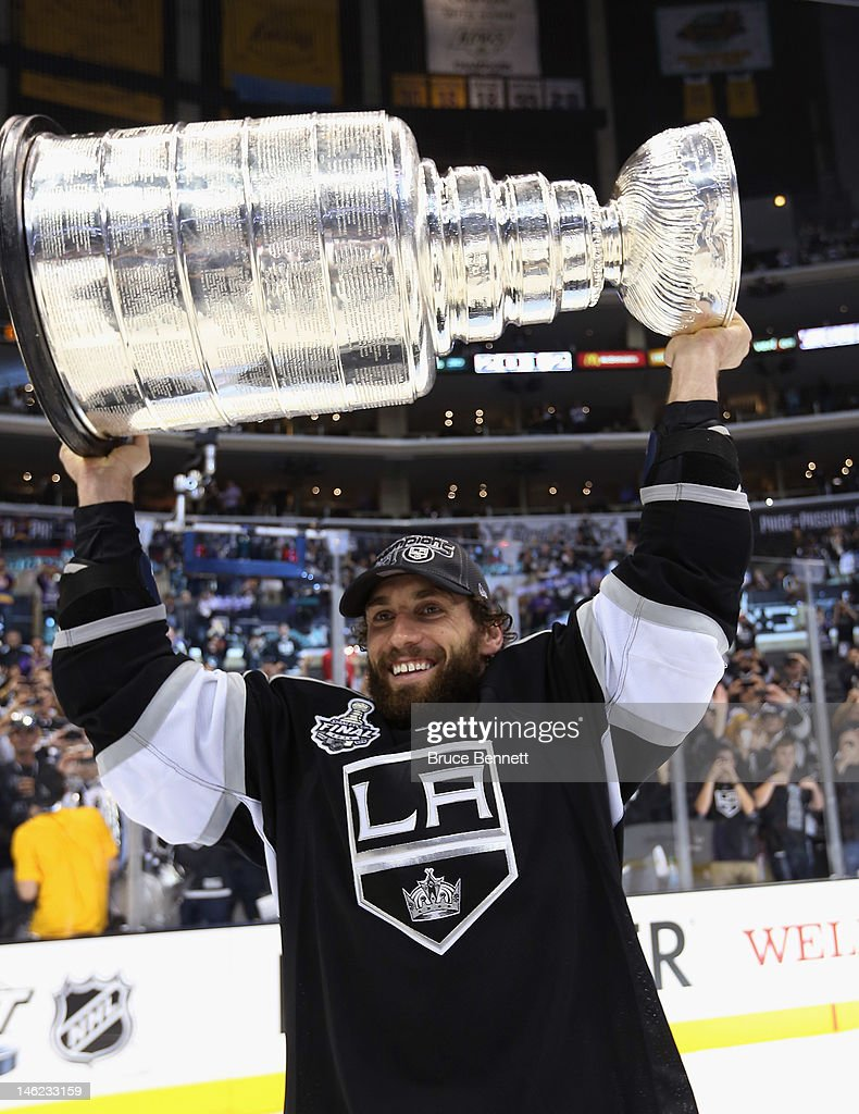 <a gi-track='captionPersonalityLinkClicked' href=/galleries/search?phrase=Jarret+Stoll&family=editorial&specificpeople=204632 ng-click='$event.stopPropagation()'>Jarret Stoll</a> #28 of the Los Angeles Kings holds up the Stanley Cup after the Kings defeated the New Jersey Devils 6-1 to win the Stanley Cup series 4-2 in Game Six of the 2012 Stanley Cup Final at Staples Center on June 11, 2012 in Los Angeles, California.