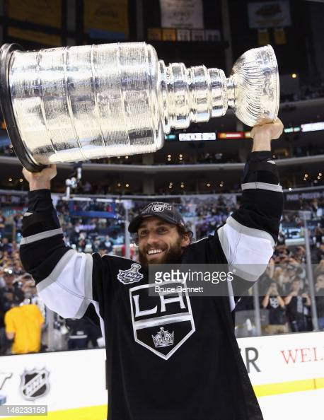 Jarret Stoll of the Los Angeles Kings holds up the Stanley Cup after the Kings defeated the New Jersey Devils 61 to win the Stanley Cup series 42 in...