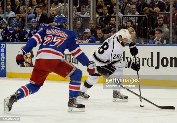 Jarret Stoll of the Los Angeles Kings is challenged by Ryan McDonagh of the New York Rangers in Game Three of the 2014 Stanley Cup Final at Madison...