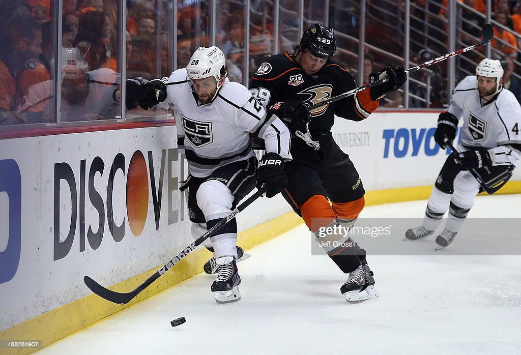 <a gi-track='captionPersonalityLinkClicked' href=/galleries/search?phrase=Jarret+Stoll&family=editorial&specificpeople=204632 ng-click='$event.stopPropagation()'>Jarret Stoll</a> #28 of the Los Angeles Kings is checked by <a gi-track='captionPersonalityLinkClicked' href=/galleries/search?phrase=Matt+Beleskey&family=editorial&specificpeople=570471 ng-click='$event.stopPropagation()'>Matt Beleskey</a> #39 of the Anaheim Ducks in the first period of Game One of the Second Round of the 2014 NHL Stanley Cup Playoffs at Honda Center on May 3, 2014 in Anaheim, California.
