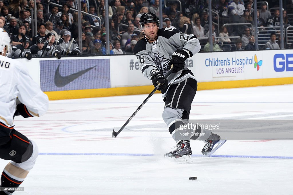 Jarret Stoll #28 of the Los Angeles Kings passes the puck against the Anaheim Ducks at Staples Center on April 12, 2014 in Los Angeles, California.