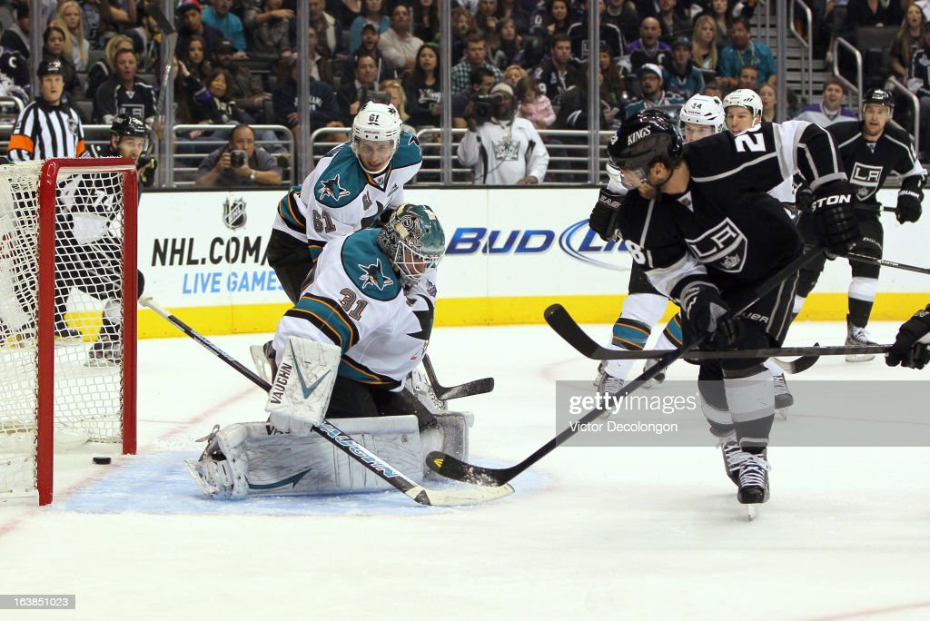 Jarret Stoll #28 of the Los Angeles Kings puts a backhand shot for a goal past goaltender Antti Niemi #31 of the San Jose Sharks in the second period during the NHL game at Staples Center on March 16, 2013 in Los Angeles, California. The Kings defeated the Sharks 5-2.