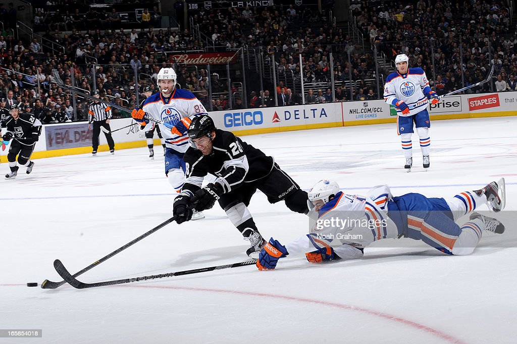 <a gi-track='captionPersonalityLinkClicked' href=/galleries/search?phrase=Jarret+Stoll&family=editorial&specificpeople=204632 ng-click='$event.stopPropagation()'>Jarret Stoll</a> #28 of the Los Angeles Kings reaches for the puck against <a gi-track='captionPersonalityLinkClicked' href=/galleries/search?phrase=Justin+Schultz&family=editorial&specificpeople=5370958 ng-click='$event.stopPropagation()'>Justin Schultz</a> #19 of the Edmonton Oilers at Staples Center on April 6, 2013 in Los Angeles, California.
