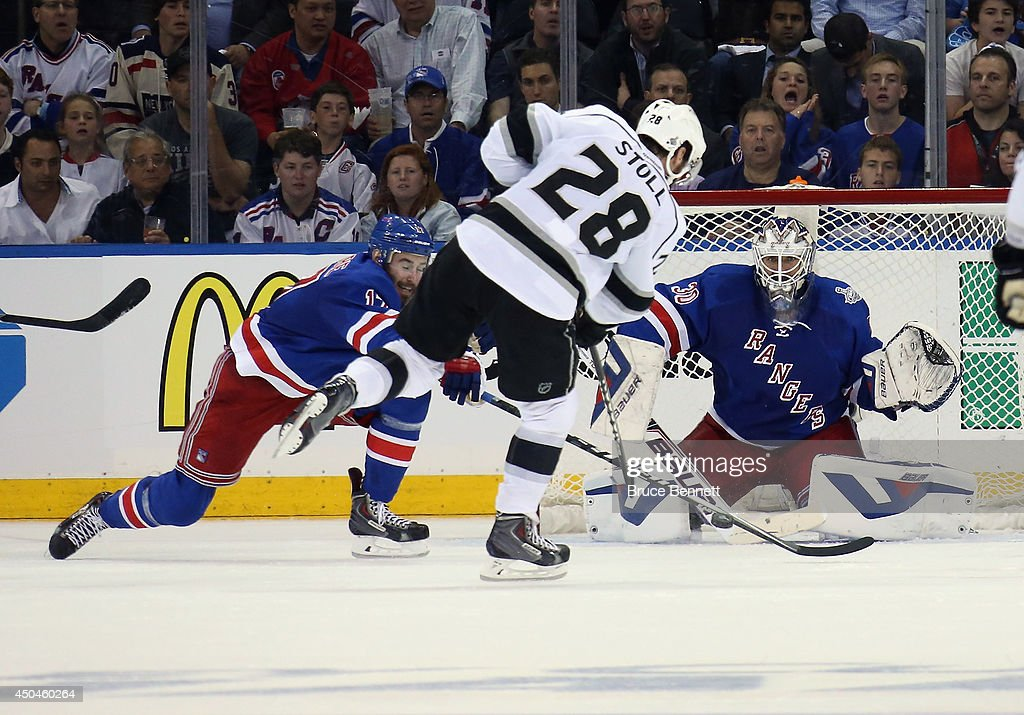 Jarret Stoll #28 of the Los Angeles Kings shoots on Henrik Lundqvist #30 of the New York Rangers with John Moore #17 of the New York Rangers defending during the second period of Game Four of the 2014 NHL Stanley Cup Final at Madison Square Garden on June 11, 2014 in New York, New York.