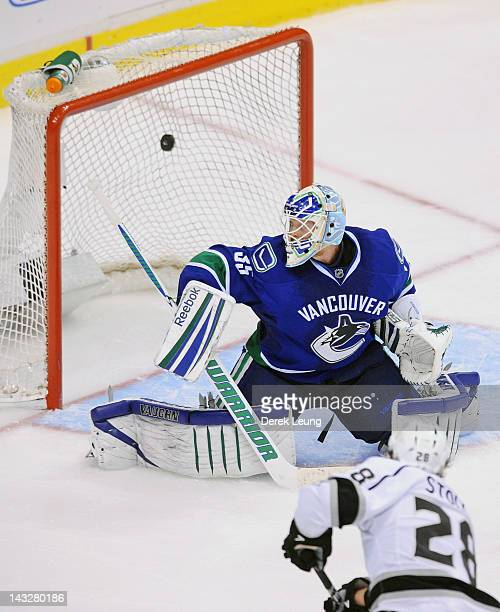 Jarret Stoll of the Los Angeles Kings shoots the puck past Cory Schneider of the Vancouver Canucks at 427 of the OT period in Game Five of the...