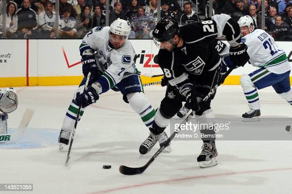 Jarret Stoll of the Los Angeles Kings skates with the puck against Dan Hamhuis of the Vancouver Canucks in Game Four of the Western Conference...