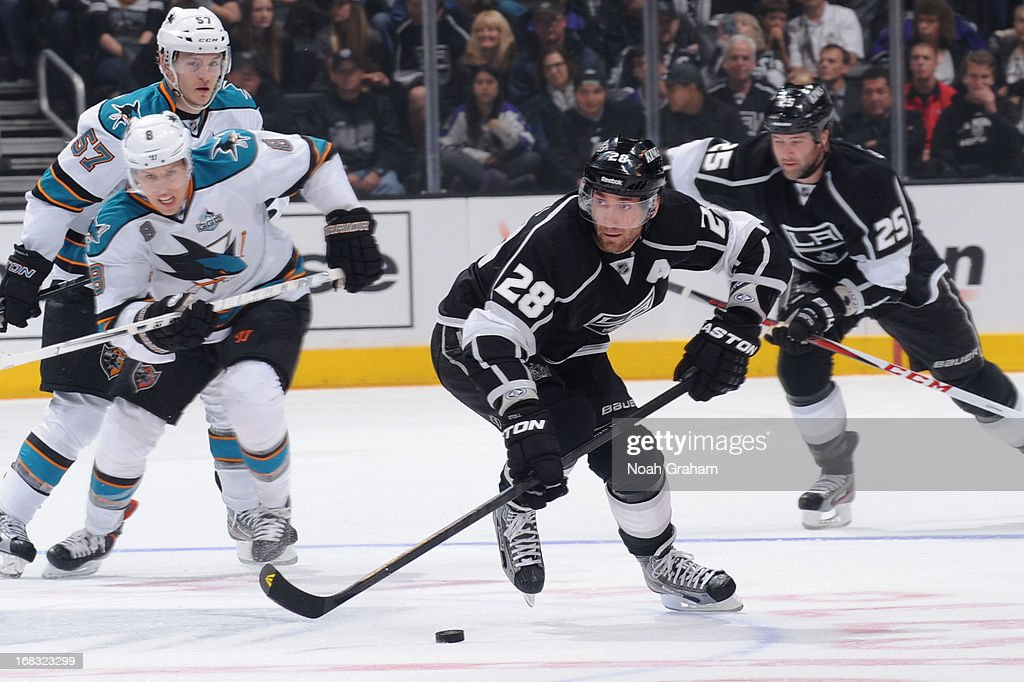 <a gi-track='captionPersonalityLinkClicked' href=/galleries/search?phrase=Jarret+Stoll&family=editorial&specificpeople=204632 ng-click='$event.stopPropagation()'>Jarret Stoll</a> #28 of the Los Angeles Kings skates with the puck against the San Jose Sharks at Staples Center on April 27, 2013 in Los Angeles, California.