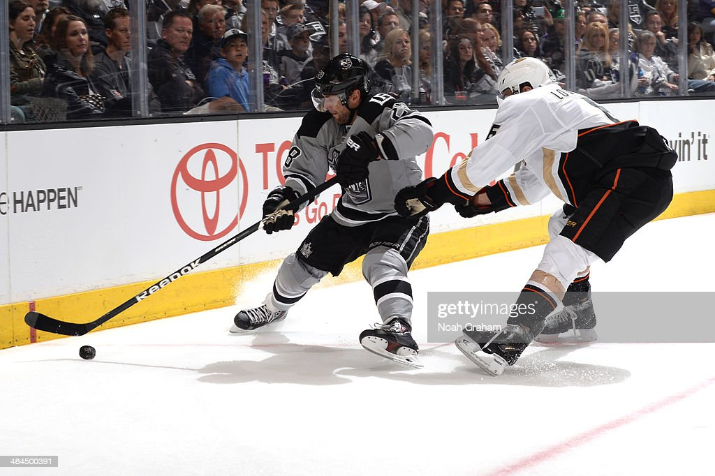 Jarret Stoll #28 of the Los Angeles Kings skates with the puck against Ben Lovejoy #6 of the Anaheim Ducks at Staples Center on April 12, 2014 in Los Angeles, California.