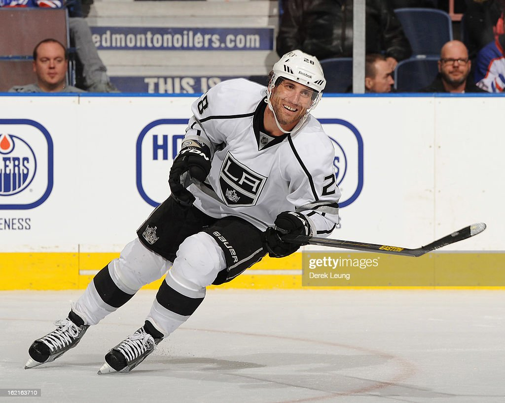 <a gi-track='captionPersonalityLinkClicked' href=/galleries/search?phrase=Jarret+Stoll&family=editorial&specificpeople=204632 ng-click='$event.stopPropagation()'>Jarret Stoll</a> #28 of the Los Angeles Kings smiles as he skates against the Edmonton Oilers during an NHL game at Rexall Place on February 19, 2013 in Edmonton, Alberta, Canada. The Los Angeles Kings won 3-1.