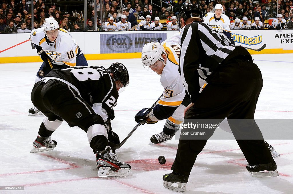 <a gi-track='captionPersonalityLinkClicked' href=/galleries/search?phrase=Jarret+Stoll&family=editorial&specificpeople=204632 ng-click='$event.stopPropagation()'>Jarret Stoll</a> #28 of the Los Angeles Kings takes the face off against Colin Wilson #33 of the Nashville Predators at Staples Center on January 31, 2013 in Los Angeles, California.