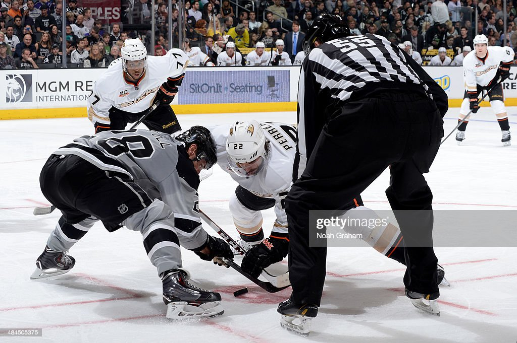 <a gi-track='captionPersonalityLinkClicked' href=/galleries/search?phrase=Jarret+Stoll&family=editorial&specificpeople=204632 ng-click='$event.stopPropagation()'>Jarret Stoll</a> #28 of the Los Angeles Kings takes the face-off against <a gi-track='captionPersonalityLinkClicked' href=/galleries/search?phrase=Mathieu+Perreault&family=editorial&specificpeople=776813 ng-click='$event.stopPropagation()'>Mathieu Perreault</a> #22 of the Anaheim Ducks at Staples Center on April 12, 2014 in Los Angeles, California.