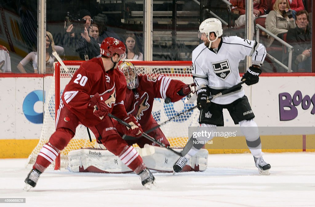 Jarret Stoll #28 of the Los Angeles Kings tips the puck past goaltender Mike Smith #41 of the Arizona Coyotes for a goal as Chris Summers #20 watches during the second period at Gila River Arena on December 4, 2014 in Glendale, Arizona.