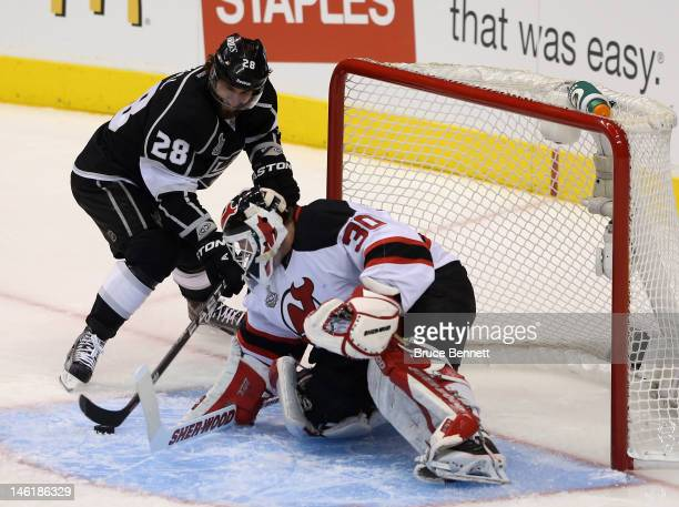Jarret Stoll of the Los Angeles Kings tries for a shot point blank on goaltender Martin Brodeur of the New Jersey Devils in the first period of Game...