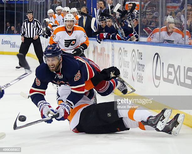 Jarret Stoll of the New York Rangers flies over Chris VandeVelde of the Philadelphia Flyers during the second period at Madison Square Garden on...
