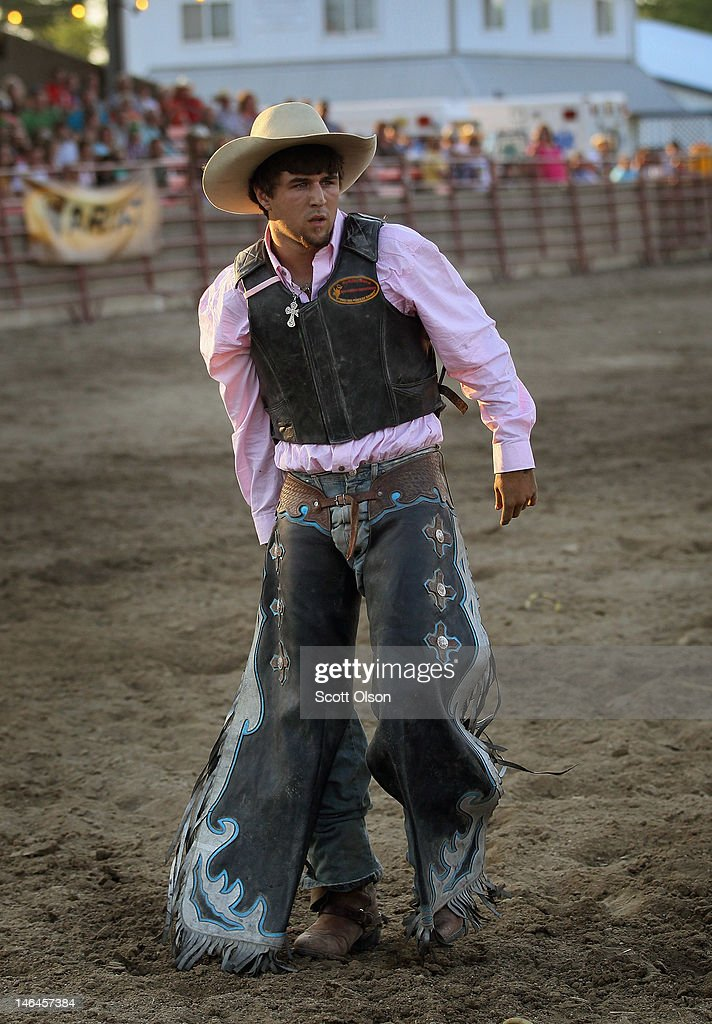Jarret Summers limps out of the arena after being thrown in the saddle bronc competition at the Illinois High School Rodeo Association State Finals on June 16, 2012 in Altamont, Illinois. Winners in the competition will go on to compete in the high school national championships July 15-21 in Rock Springs, Wyoming.