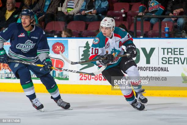Jarret Tyszka of the Seattle Thunderbirds stick checks Nick Merkley of the Kelowna Rockets on February 13 2017 at Prospera Place in Kelowna British...