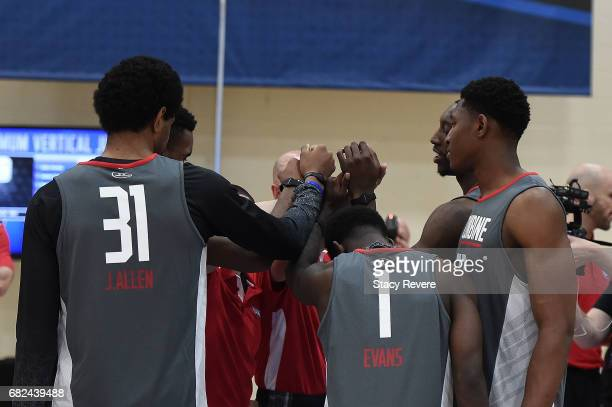 Jarrett Allen Jawun Evans and Ike Anigbogu gather at midcourt during Day Two of the NBA Draft Combine at Quest MultiSport Complex on May 12 2017 in...