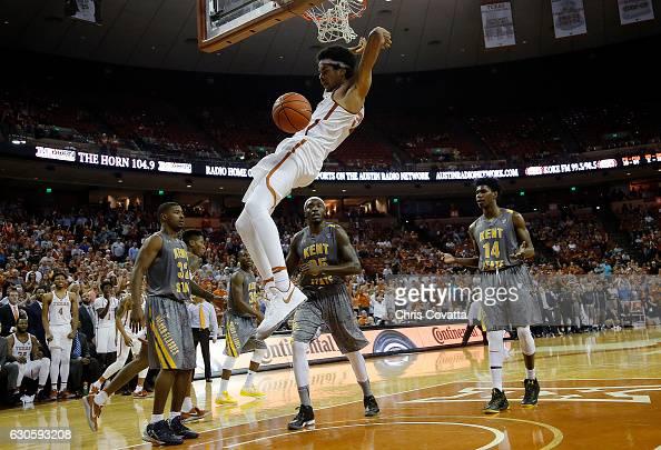 Jarrett Allen of the Texas Longhorns slam dunks against the Kent State Golden Flashes at the Frank Erwin Center on December 27 2016 in Austin Texas