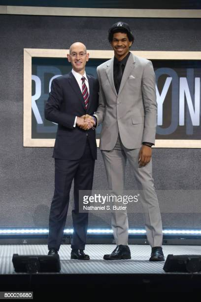 Jarrett Allen shakes hands with NBA Commissioner Adam Silver after being selected twenty second overall by the Brooklyn Nets during the 2017 NBA...