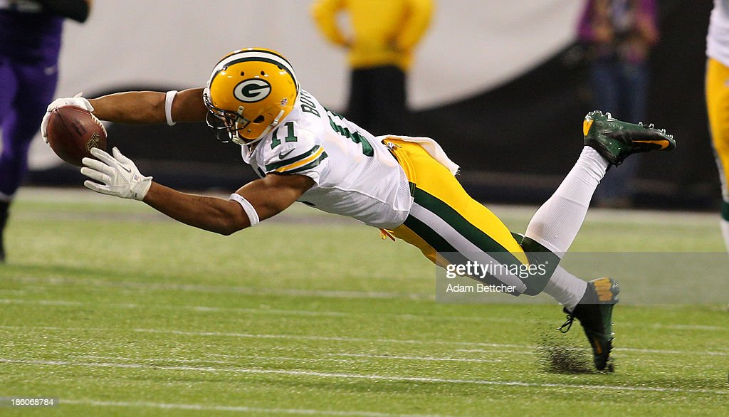 Jarrett Boykin #11 of the Green Bay Packers advances the ball against the Minnesota Vikings on October 27, 2013 at Mall of America Field at the Hubert Humphrey Metrodome in Minneapolis, Minnesota.
