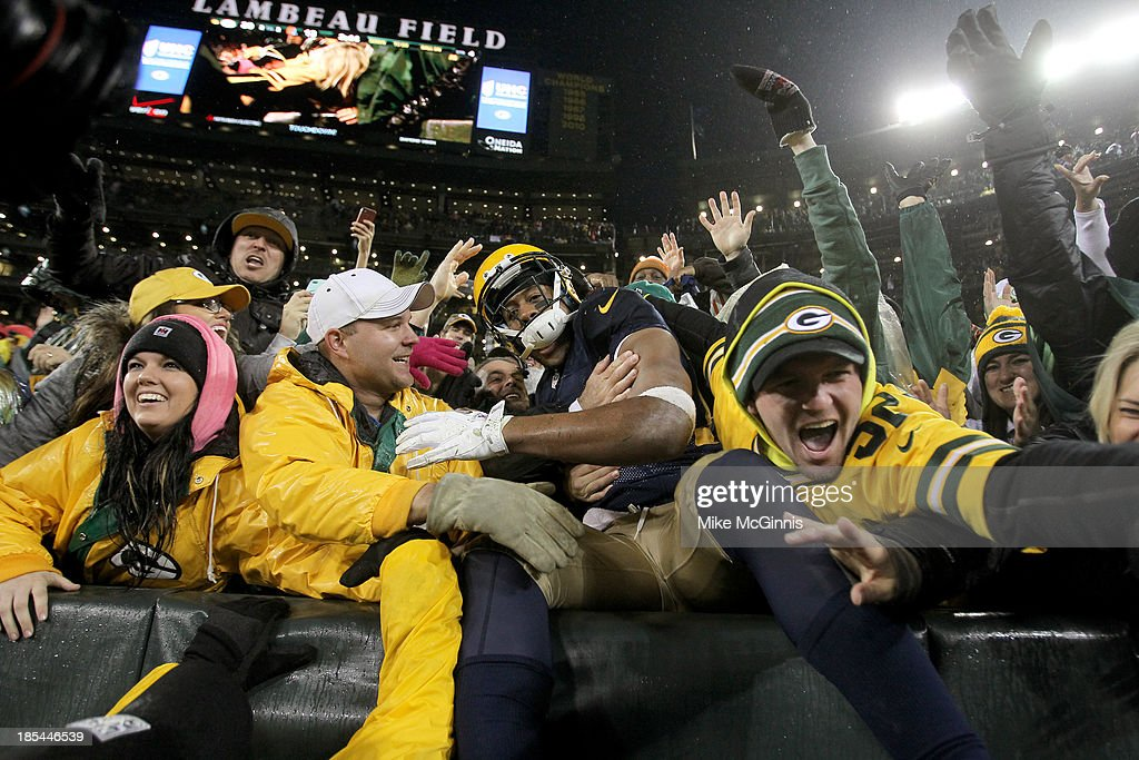 Jarrett Boykin #11 of the Green Bay Packers does a Lambeau Leap after scoring a touchdown during the fourth quarter against the Cleveland Browns at Lambeau Field on October 20, 2013 in Green Bay, Wisconsin.