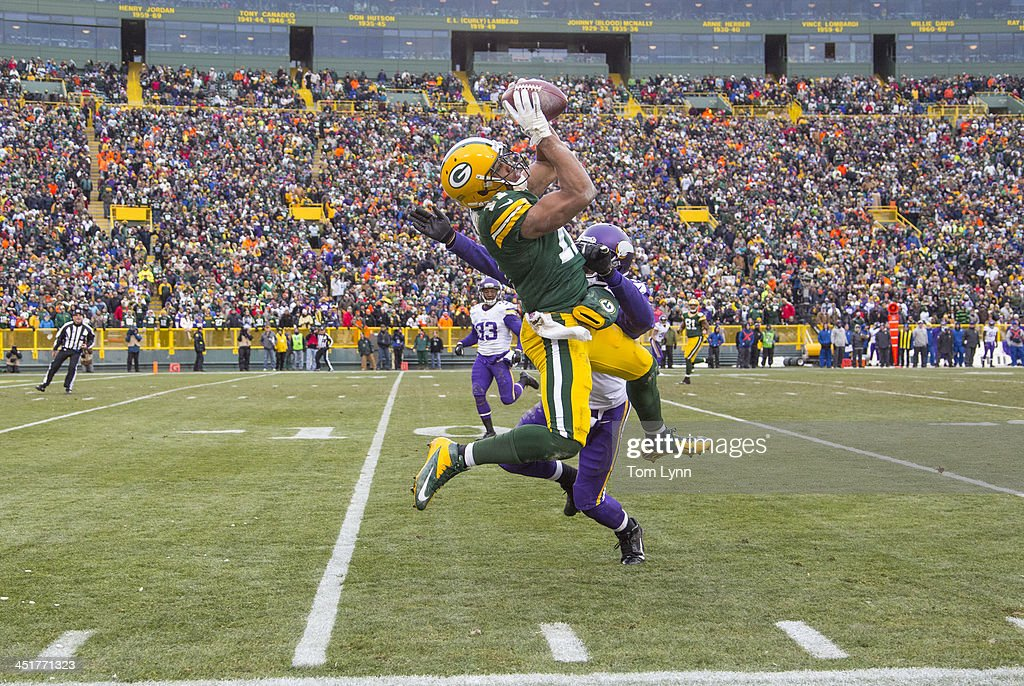 <a gi-track='captionPersonalityLinkClicked' href=/galleries/search?phrase=Jarrett+Boykin&family=editorial&specificpeople=5543648 ng-click='$event.stopPropagation()'>Jarrett Boykin</a> #11 of the Green Bay Packers makes a catch against Chris Cook #20 of the Minnesota Vikings in overtime at Lambeau Field on November 24, 2013 in Green Bay, Wisconsin. The game ended in a 26 all tie.