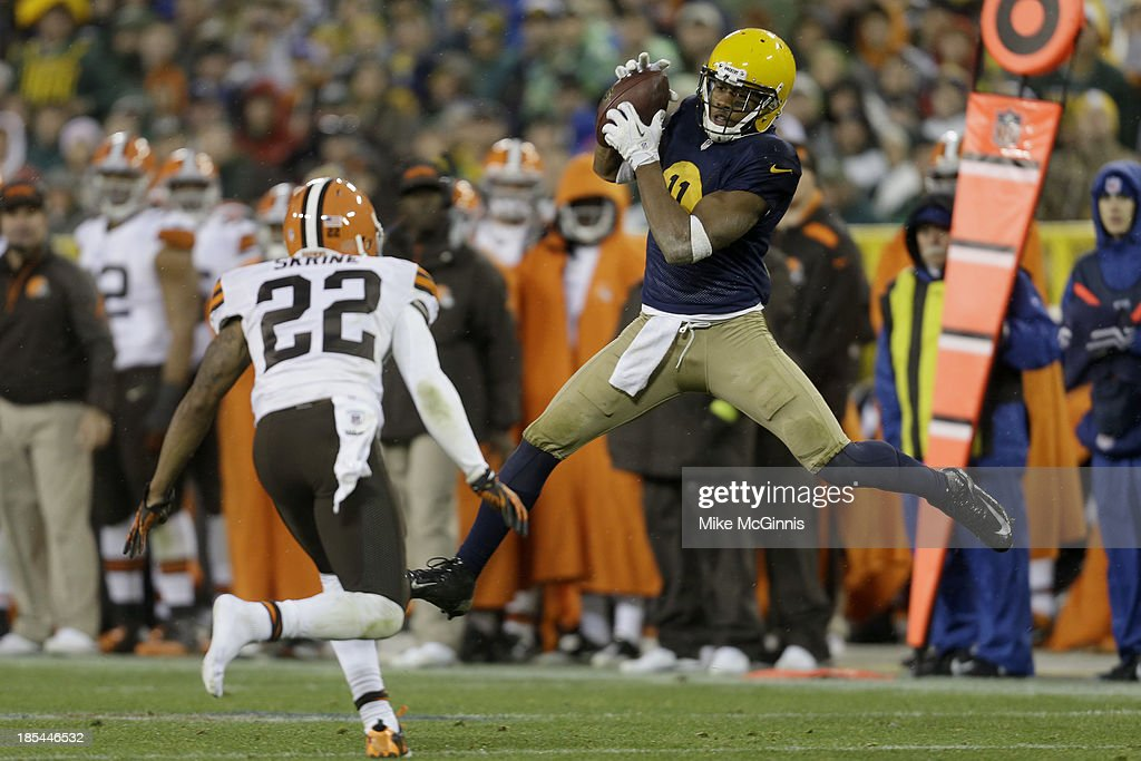 <a gi-track='captionPersonalityLinkClicked' href=/galleries/search?phrase=Jarrett+Boykin&family=editorial&specificpeople=5543648 ng-click='$event.stopPropagation()'>Jarrett Boykin</a> #11 of the Green Bay Packers makes a leaping catch during the fourth quarter against the Cleveland Browns at Lambeau Field on October 20, 2013 in Green Bay, Wisconsin.