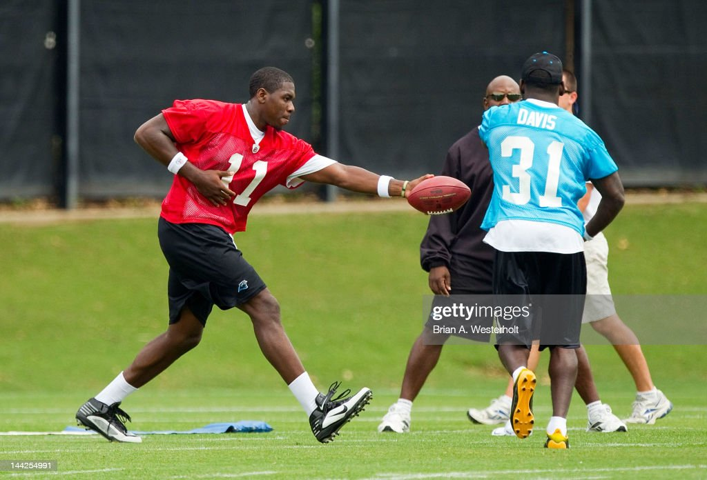 <a gi-track='captionPersonalityLinkClicked' href=/galleries/search?phrase=Jarrett+Brown&family=editorial&specificpeople=4056499 ng-click='$event.stopPropagation()'>Jarrett Brown</a> #11 hands the ball off to James Davis #31 at Carolina Panthers Rookie Camp on May 12, 2012 in Charlotte, North Carolina.