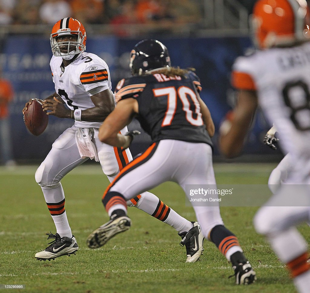 <a gi-track='captionPersonalityLinkClicked' href=/galleries/search?phrase=Jarrett+Brown&family=editorial&specificpeople=4056499 ng-click='$event.stopPropagation()'>Jarrett Brown</a> #3 of the Cleveland Browns loooks for a receiver under pressure from Nick Reed #70 of the Chicago Bears during a preseason game at Soldier Field on September 1, 2011 in Chicago, Illinois.