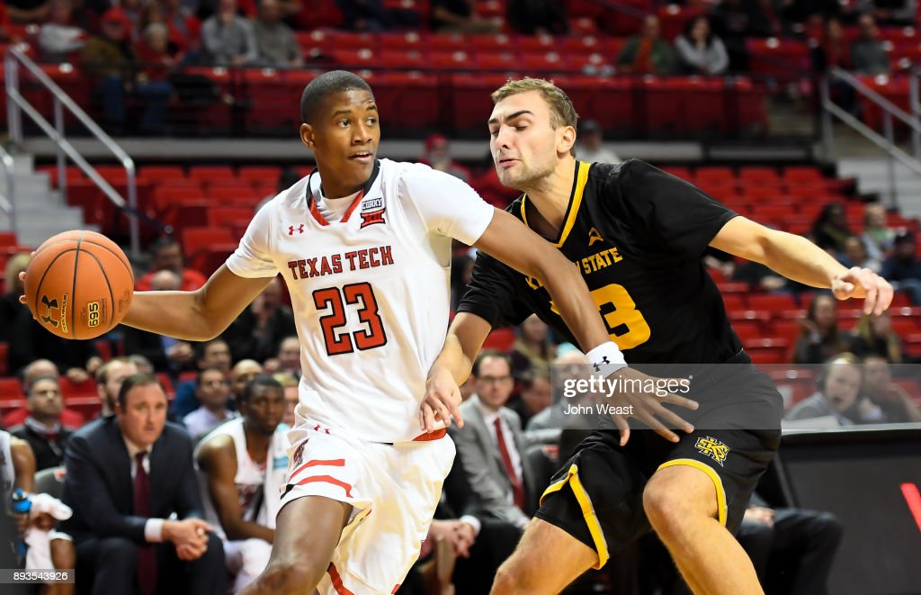 Jarrett Culver #23 of the Texas Tech Red Raiders drives to the basket against Kosta Jankovic #33 of the Kennesaw State Owls during the game on December 13, 2017 at United Supermarkets Arena in Lubbock, Texas. Texas Tech defeated Kennesaw State 82-53.