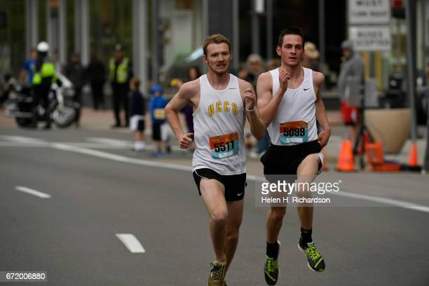 Jarrett Eller left bib and Sam Nofziger right bib battle it out for 2nd and third place during the 35th annual Cherry Creek Sneak 5 Mile race on...