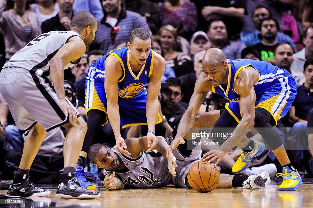 Jarrett Jack #2 and Stephen Curry #30 of the Golden State Warriors reach for a loose ball against Gary Neal #14 of the San Antonio Spurs in Game One of the Western Conference Semifinals during the 2013 NBA Playoffs on May 6, 2013 at the AT&T Center in San Antonio, Texas.