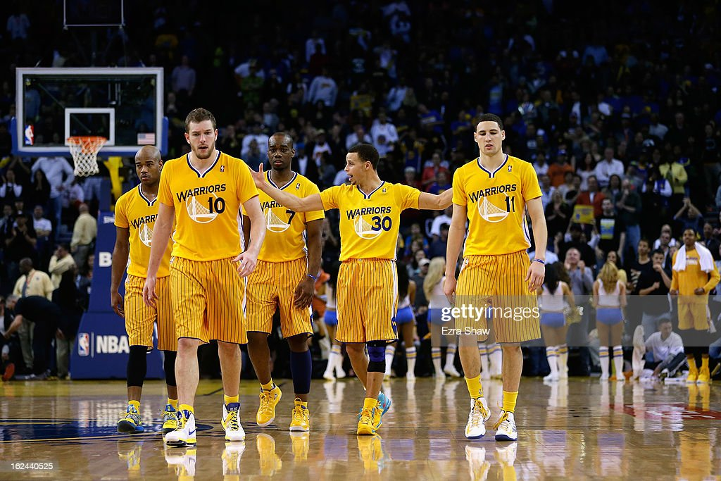 Jarrett Jack #2, David Lee #10, Carl Landry #7, Klay Thompson #11, and Stephen Curry #30 of the Golden State Warriors walk on to the court during their game against the San Antonio Spurs at Oracle Arena on February 22, 2013 in Oakland, California. The Warriors are wearing new short-sleeved uniforms for the first time. The Warriors won the game in overtime.