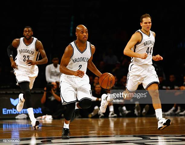 Jarrett Jack of the Brooklyn Nets dribbles against the Boston Celtics during their Preseason game at Barclays Center on October 14 2015 in New York...